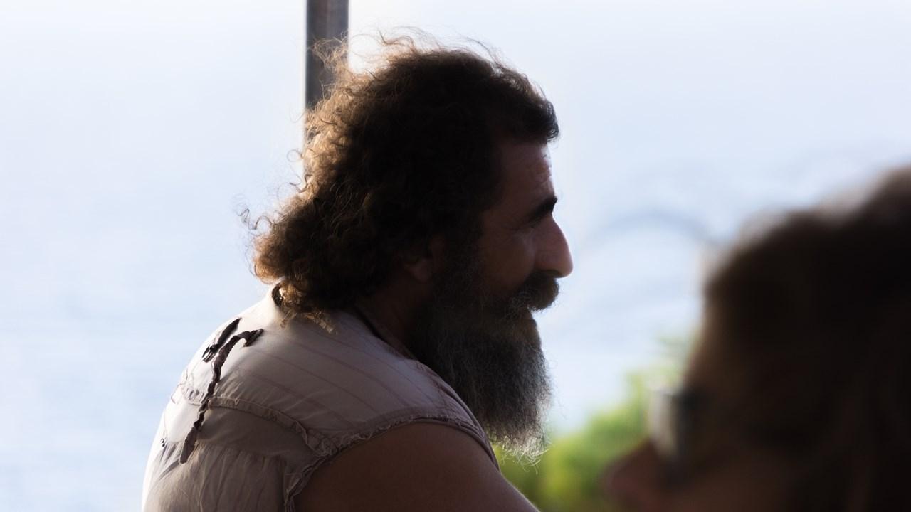 Бородатый грек-торговец